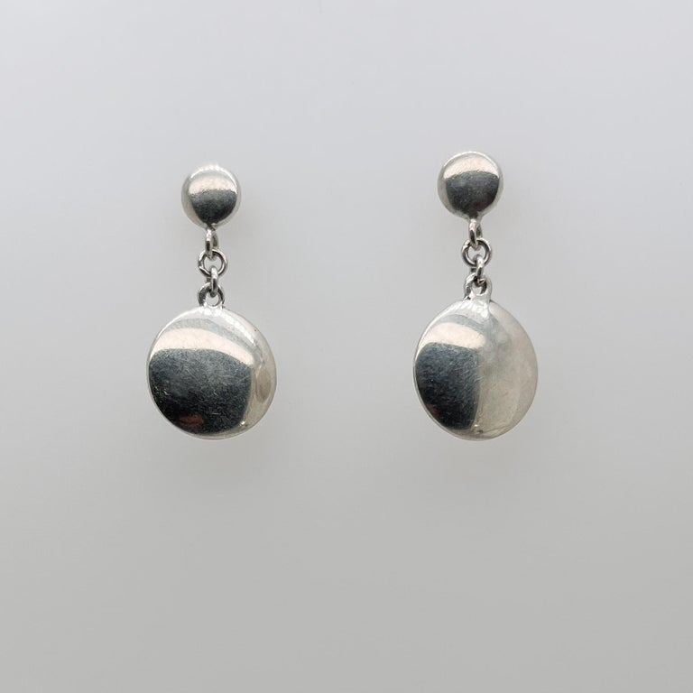 A very fine pair of vintage Tiffany & Co. dangle dot earrings.  In sterling silver.  Simple and classically elegant design by Tiffany!  Date: 21st Century  Overall Condition: It is in overall good, as-pictured, used estate condition with some very