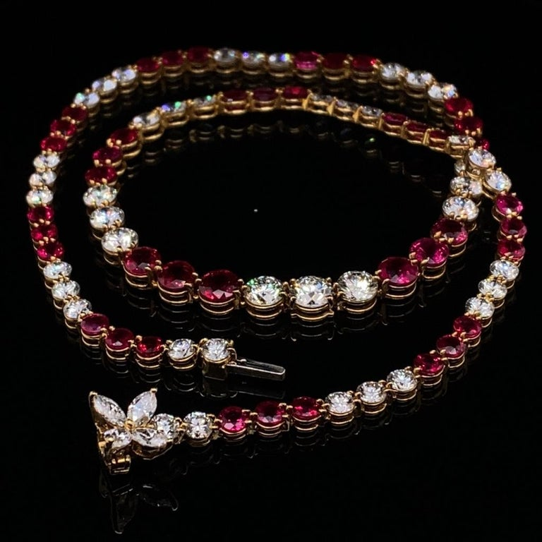 A vintage Tiffany & Co. ruby and diamond line necklace set in 18 karat yellow gold  This outstanding piece is from the recent Victoria collection by Tiffany & Co. which is currently still being sold in store and online.   The necklace comprises of