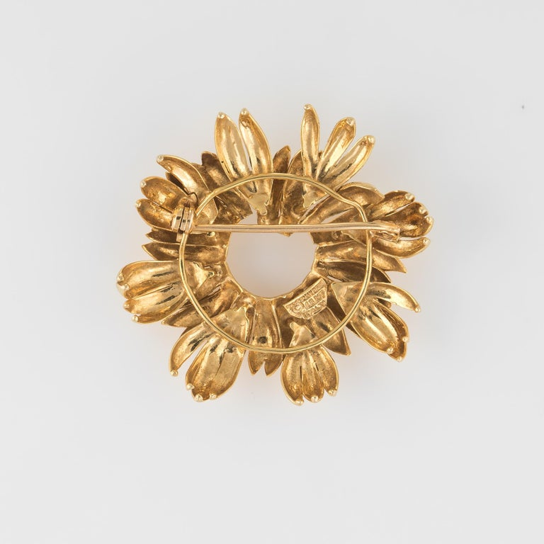 Finely detailed vintage Tiffany & Co (circa 1980s) wreath brooch crafted in 18 karat yellow gold.   The wreath features applied layers giving a lifelike appearance to the brooch.   The brooch is in very good condition.   Particulars:  Weight: 13.3