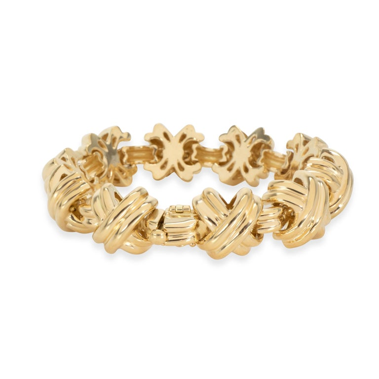 Tiffany & Co. X Bracelet in 18K Yellow Gold   PRIMARY DETAILS  SKU: 104340  Listing Title: Tiffany & Co. X Bracelet in 18K Yellow Gold  Condition Description: Retails for 15000 USD. In excellent condition and recently polished. Bracelet is 7.5