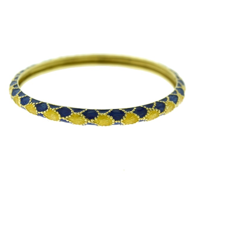 Brilliance Jewels, Miami Questions? Call Us Anytime! 786,482,8100  Size: Small to Medium! Designer: Tiffany & Co. Style: Bracelet Bangle Metal: 18k Yellow Gold Non-Metal Material: Blue Enamel Total Item Weight (grams): 25.3 Bangle Width: 5.38 mm