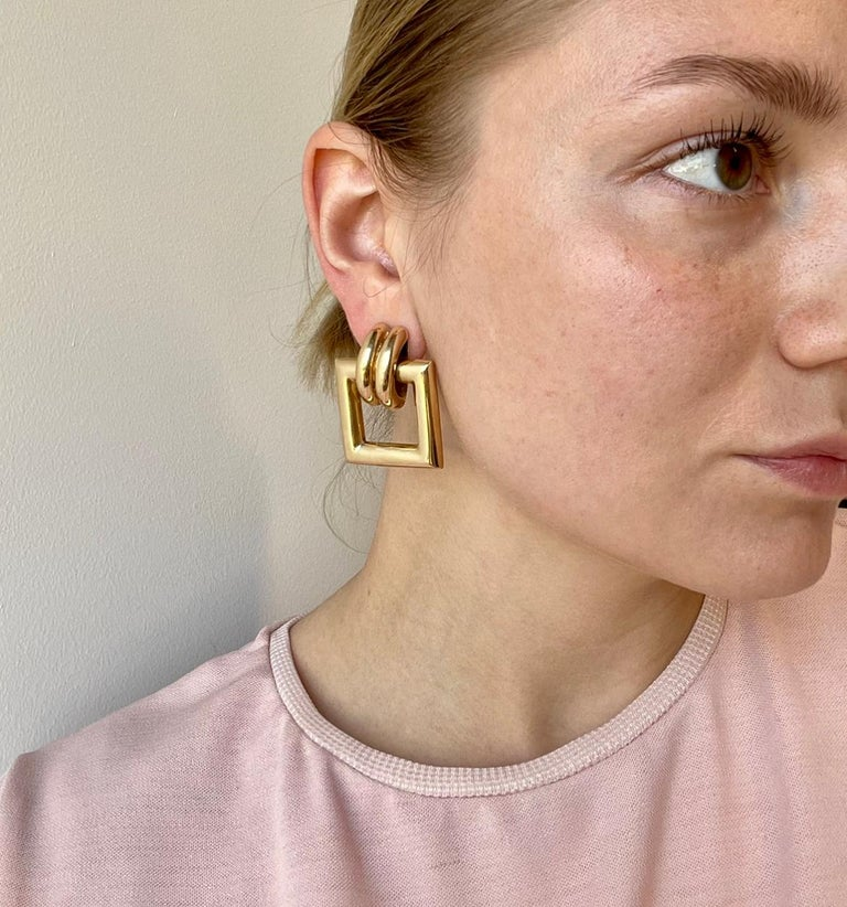 Vintage Tiffany & Co. Yellow Gold Door Knocker Earrings. Signed Tiffany, with purity marks. Circa 1990's. The length is 1 1/2 inches.   About The Piece: Solid, yellow gold jewelry has always been popular, but now it's trending even more. Own a pair