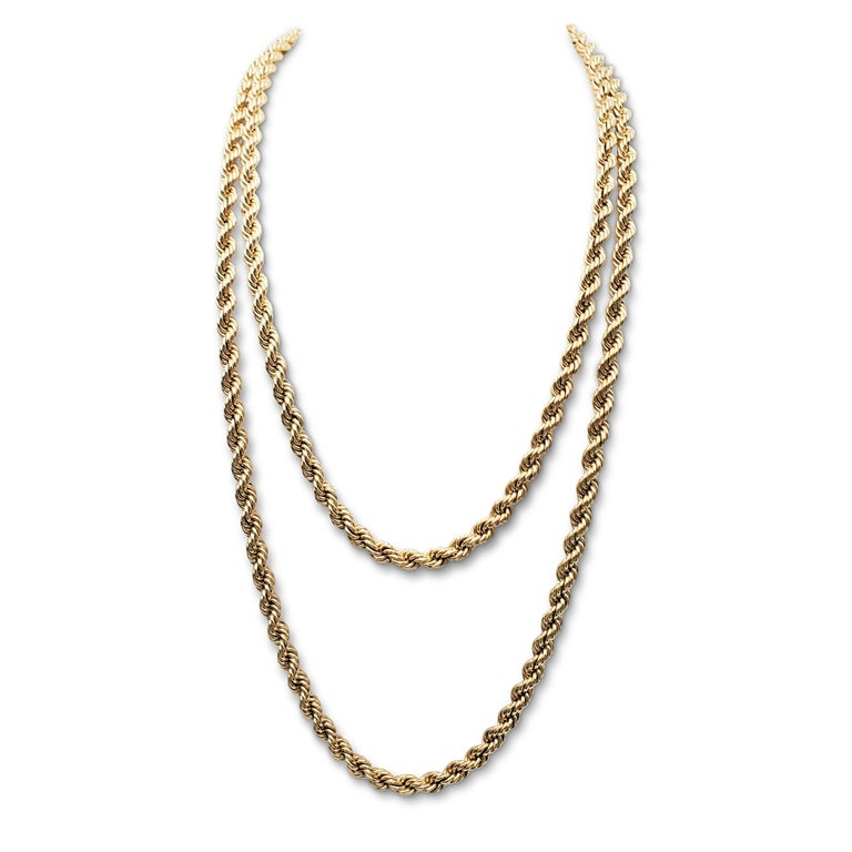 Authentic vintage Tiffany & Co. extra-long twisted rope chain necklace crafted in 14 karat yellow gold. Signed T&Co., 585. The necklace measures 60 inches in length. Not presented with the original box or papers. CIRCA 1980-1990s.  Necklace Length: