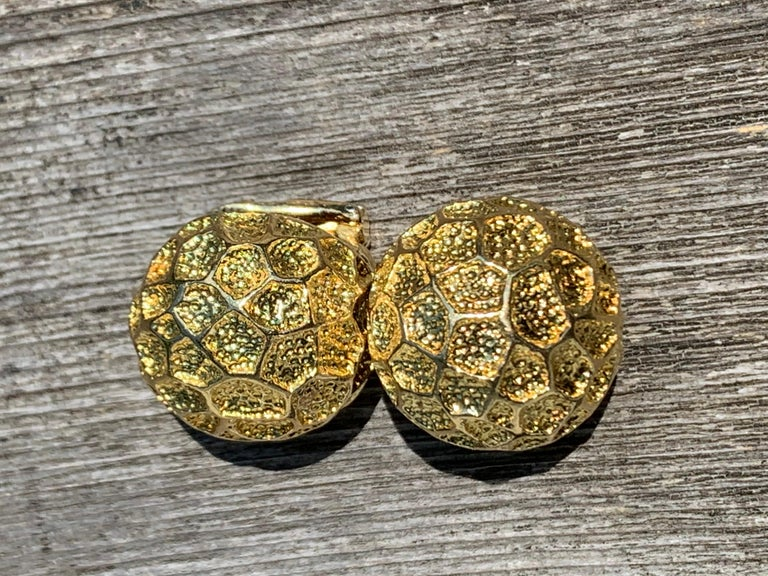 This chunky clip on earrings were designd by Tiffany to commemorate the first landing on the moon.