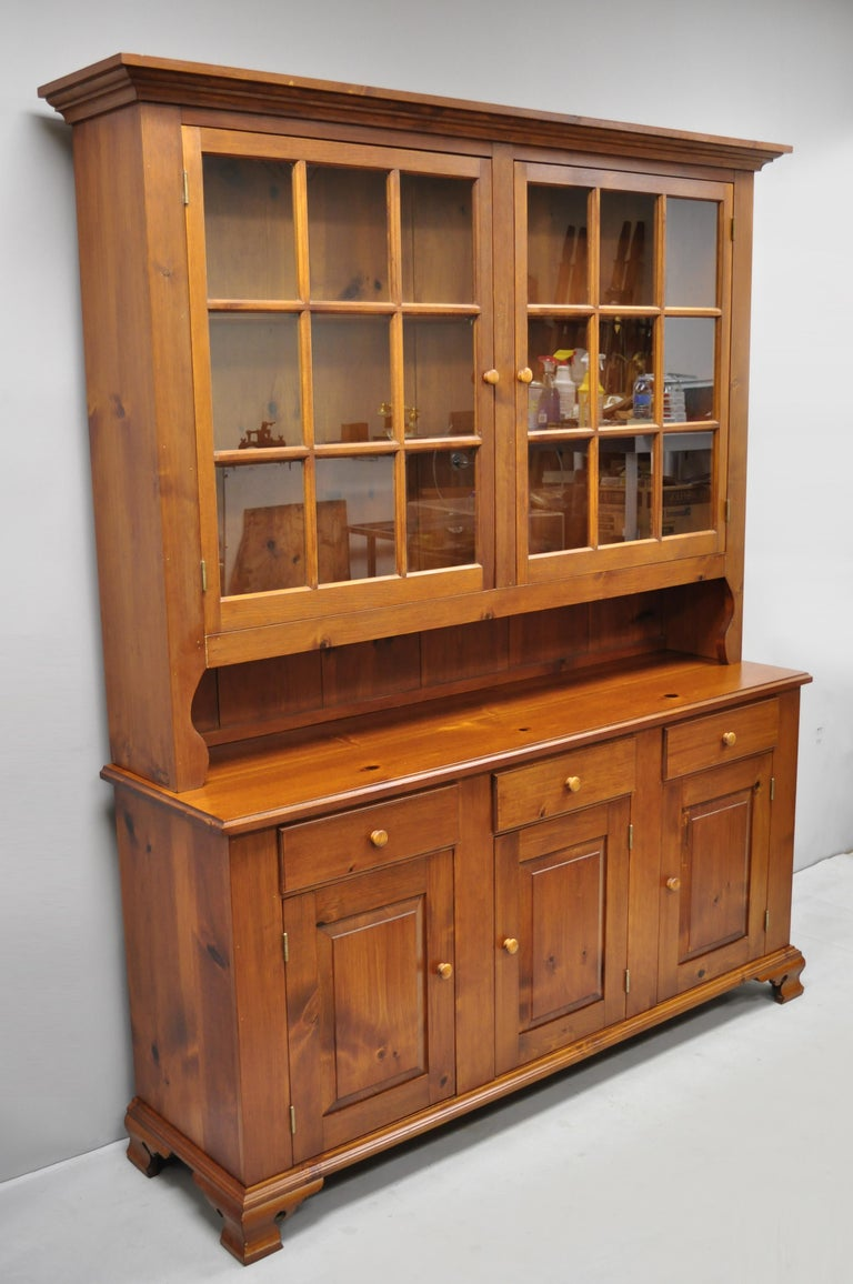 Vintage Tom Seely pine wood step back hutch cupboard china cabinet. Listing features solid wood construction, beautiful wood grain, 2 part construction, original stamp, plate groves, 3 dovetailed drawers, quality American craftsmanship, circa late