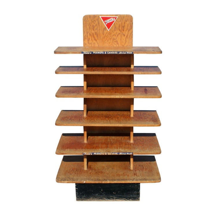 A vintage wooden stand used to display Tom's peanuts. Six shelves with an ebonized base. Nice wear and patina.