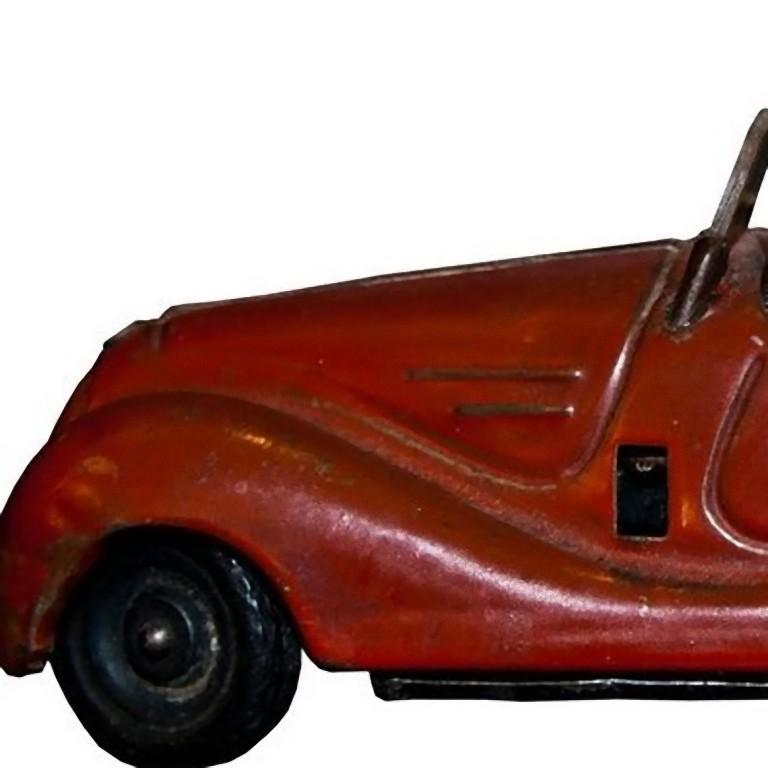 This Schuco Examico 4001 car is a wind up mechanical toy car, made between 1950s/60s.   Working stick shift and reverse. Vintage toy made in tinplate and plastic.  Lighthly scratched surface, slow clockwork. Not perfect conditions.  This
