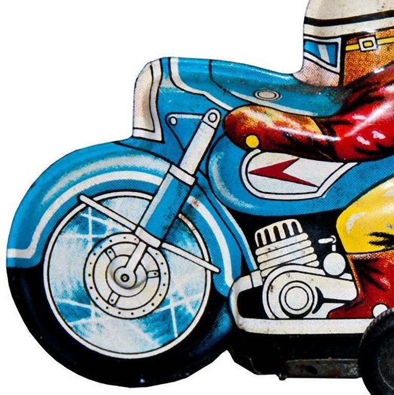 This Wind up Boy on Tricycle is an original vintage toy.