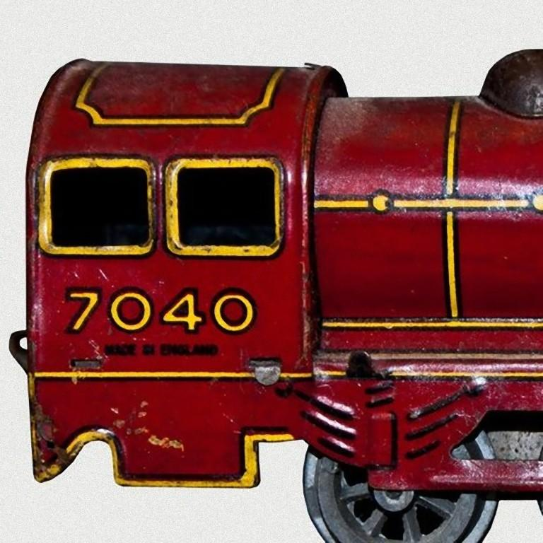 This Wind up Locomotive Wells-Brimtoy 7040 is an originale mechanical toy.  Vintage wind up toy representing a locomotive. Made in lithographed tin by Wells-Brimtoy, model n. 7040. Probably made in 1930s. Its original key and tender are not