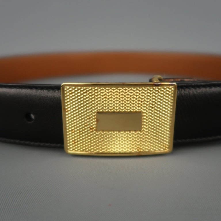 Vintage TRAFALGAR dress belt features a black strap with a yellow gold tone textured rectangular buckle. Aging on metal. As-is. Made in USA.   Very Good Pre-Owned Condition. Marked: 30/75   Length: 34.5 in. Width: 1.05 in. Fits: 27.5-30.5 in.