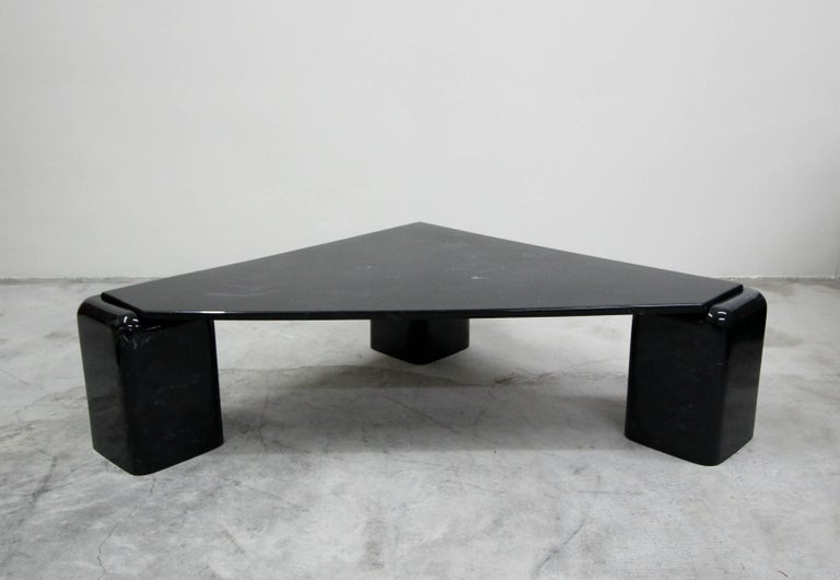Super unique, three-leg, triangular shaped, black Italian marble coffee table.  Beautiful black and white marble top and legs. Table top sets perfectly into the cutouts of the rounded legs.  True designer piece.