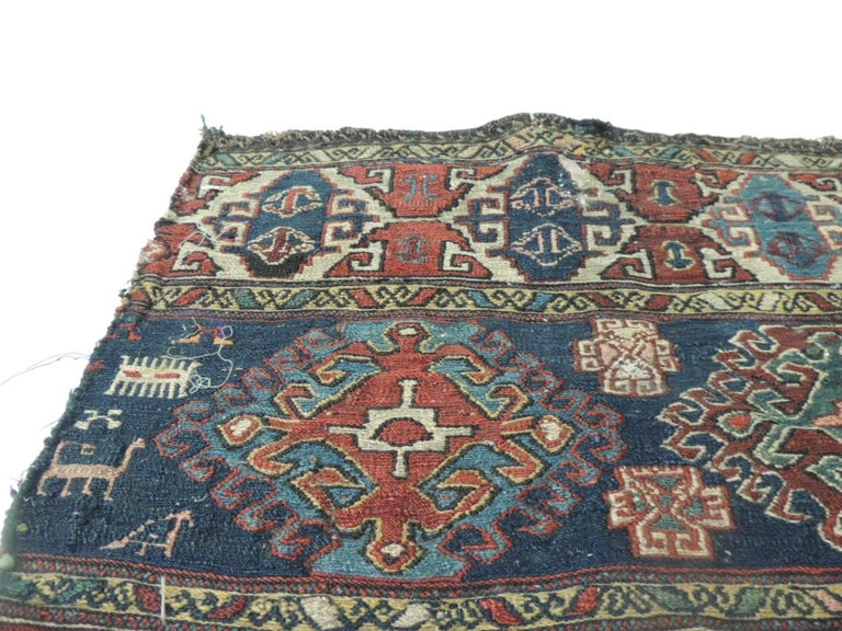 Vintage tribal design Kilim Rug fragment Vintage Shahsavan fragment of a Kilim rug in the front, and traditional Anatolian kilims all around. This piece is a Soumak which is a term used for weft wrapping weaving technique and it is woven by the