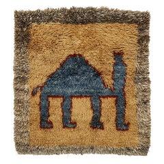 Vintage Tribal Rug with Headless Blue Camel on Desert Landscape