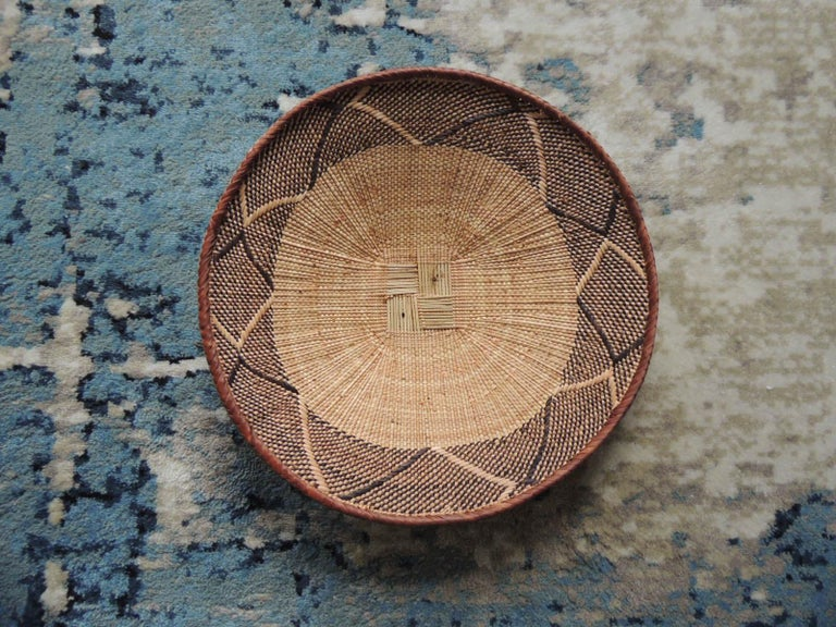 Vintage tribal tan and brown woven round African basket. Tribal woven pattern. Size: 14.5