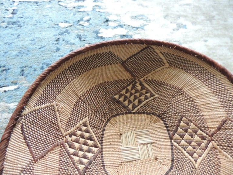 Vintage tribal tan and brown woven round African basket. Tribal woven pattern. Size: 17.5