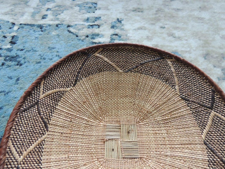 Hand-Crafted Vintage Tribal Tan and Brown Woven Round African Basket For Sale