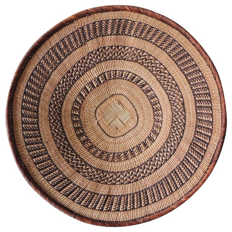 Vintage Tribal Tan and Brown Woven Round African Basket For Sale