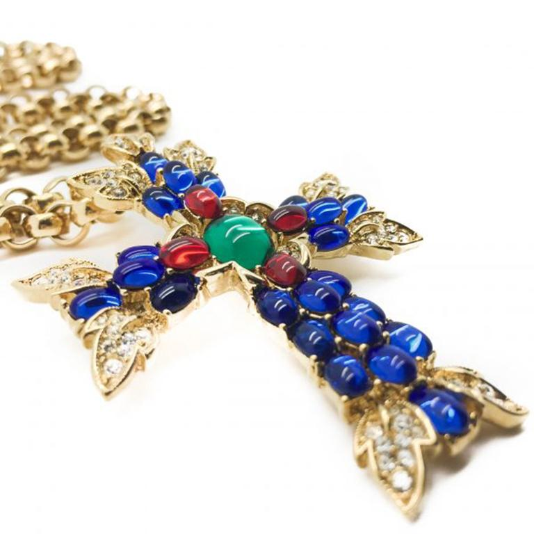 The most amazing 1990s Vintage Trifari Moghul Cross Pendant Necklace. Featuring a wonderful array of vibrant stones including cabochon blue, red and green stones in amongst tiny pave set crystal rhinestones. The colors of the faux gems reminiscent