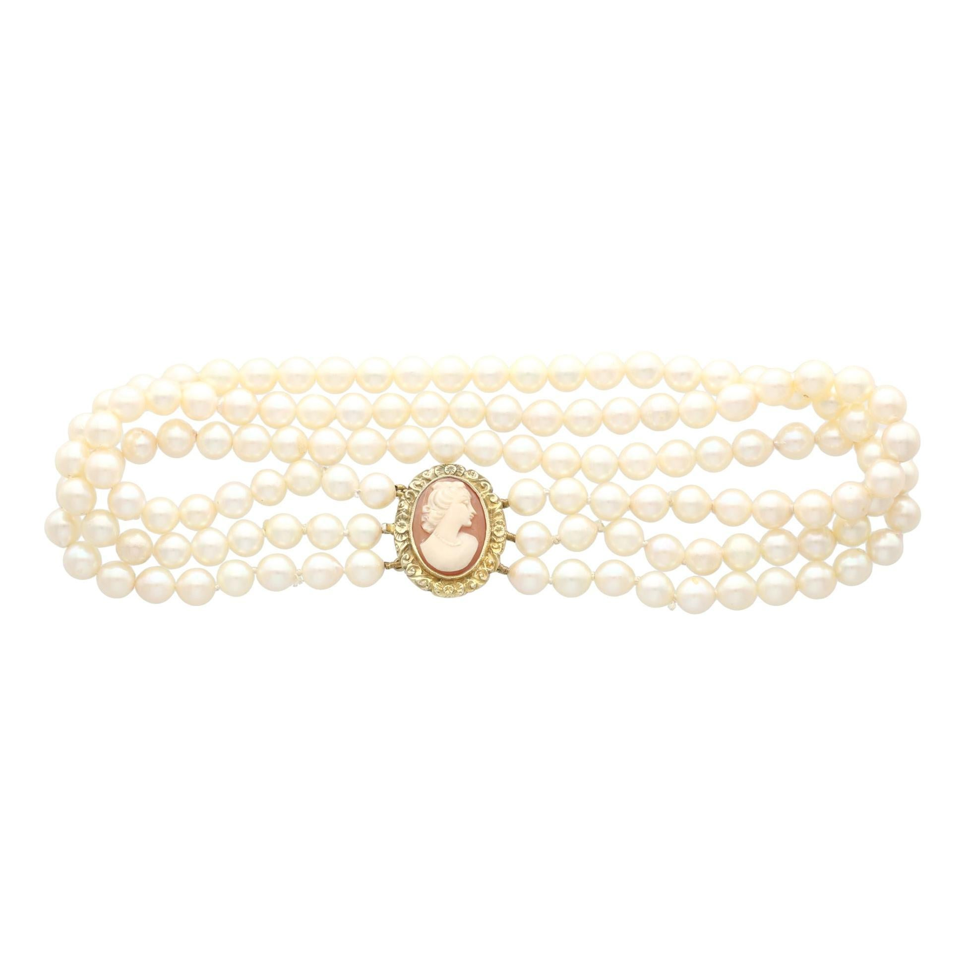 Vintage Triple Strand Cultured Pearl Choker and 9 Karat Yellow Gold Cameo Clasp