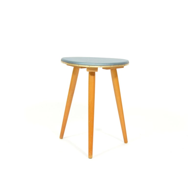 Small tripod stool (flower Stand or small side table) from 1970s. Seat coated with artificial silver grey coat. In original, very good, condition. Manufactured in Germany, during 1960s.