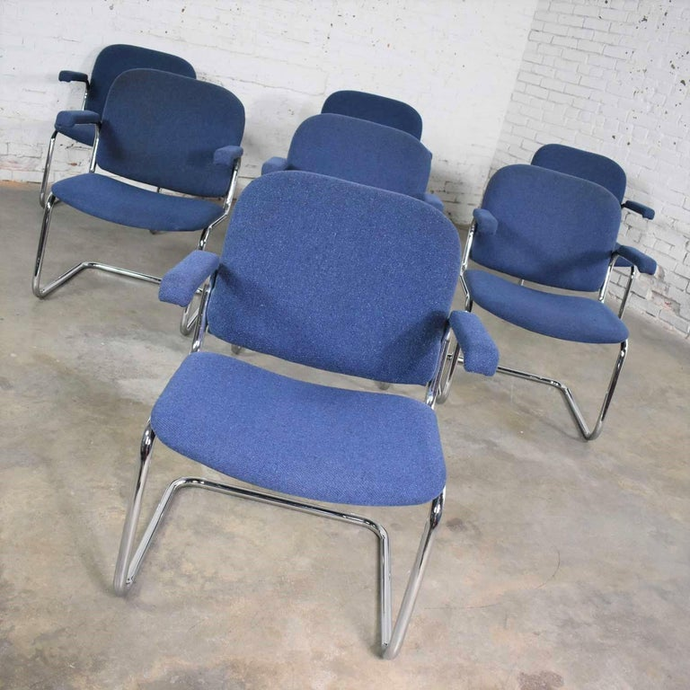 Awesome vintage cantilever tubular chrome and blue hopsack fabric upholstered lounge chairs in the manner of Thonet. There are seven chairs available, but we have priced them per chair. All are in wonderful vintage condition with normal wear for