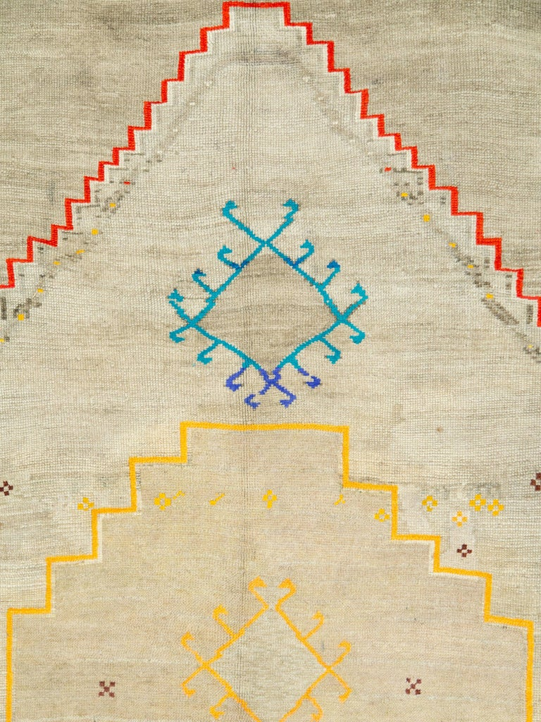 A vintage Turkish Anatolian carpet from the mid-20th century with cotton highlights.