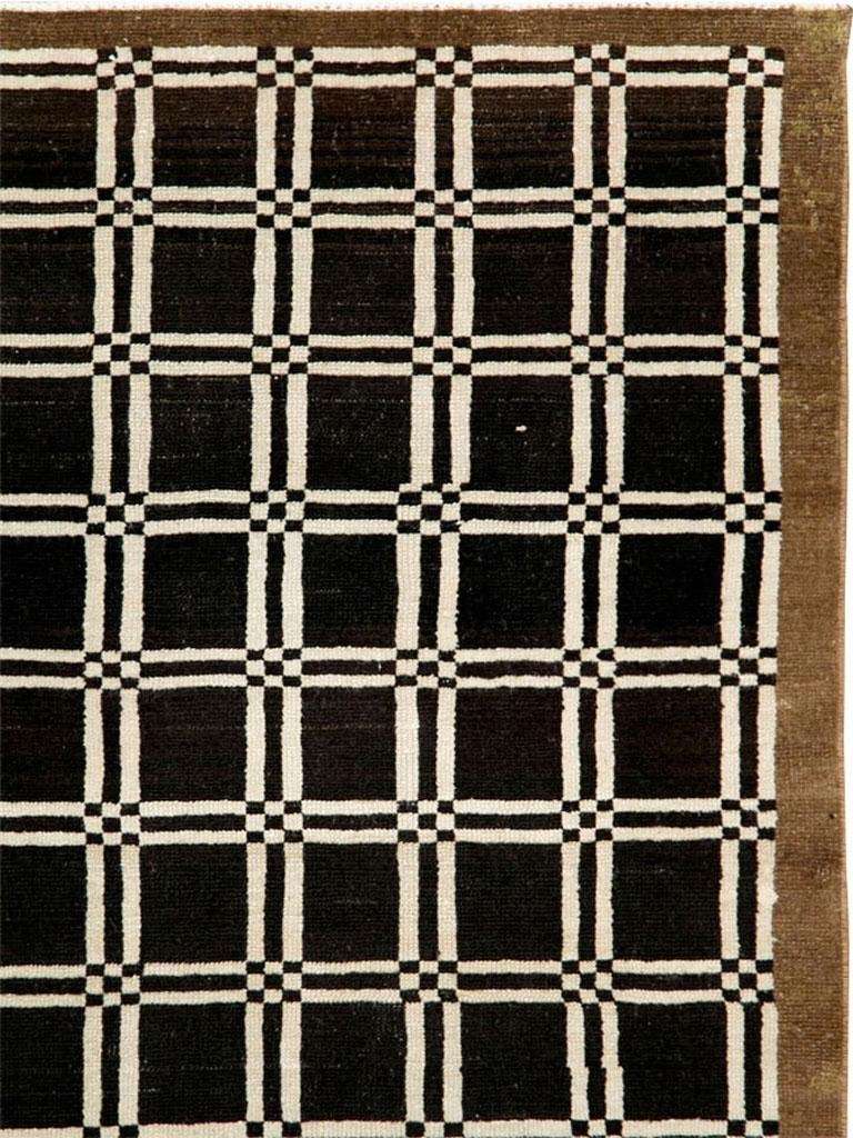 A vintage Turkish Anatolian rug from the mid-20th century. A coarse tribal piece with a very geometric Art Deco pattern in black, brown, and ivory.  Measures: 4' 3