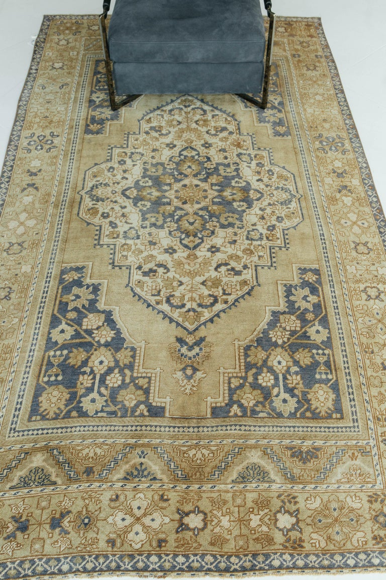 Vintage Turkish Anatolian rugs weave together dyes and colors, motifs, textures and techniques that are popular in Anatolia or Asia Minor. Symmetrical knots are also true components of Anatolian rugs alongside the diamond and floral shaped elements