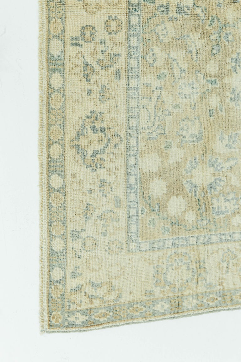 Vintage Turkish Anatolian rugs weave together dyes and colors, motifs, textures and techniques that are popular in Anatolia or Asia Minor. This Anatolian piece uses symmetry and geometric floral detailing to perfection. Colors of this antique piece
