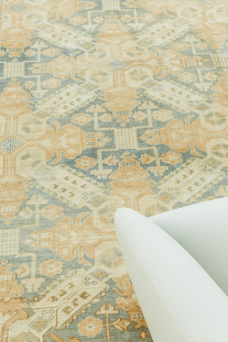 A luxurious and vintage Turkish Anatolian rug. Anatolian rugs weave together dyes and colors, motifs, textures and techniques that are popular in Anatolia or Asia Minor. This antique piece weaves together symmetry and geometric shapes to perfection.
