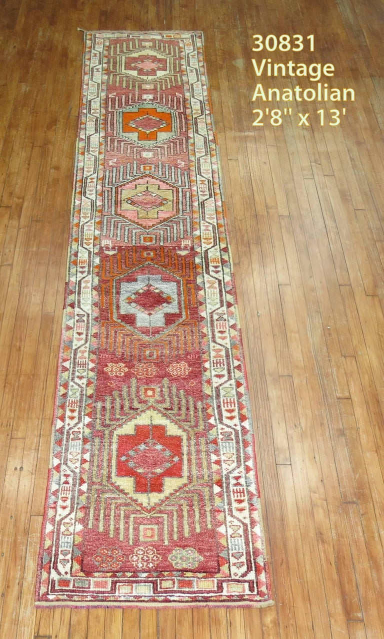 Narrow and long vintage Turkish Anatolian runner.