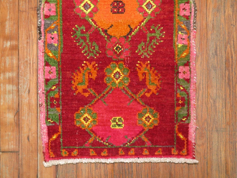 One of a kind vintage Turkish rug with intense bright colors.