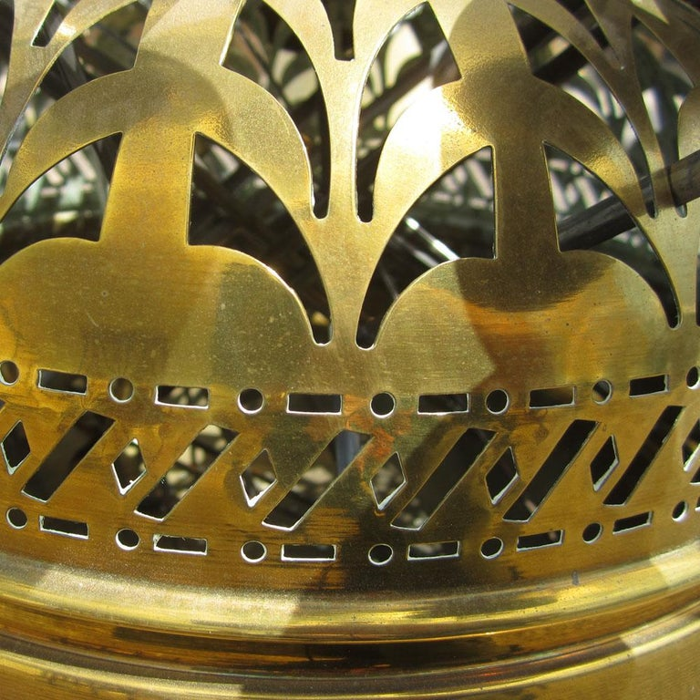 A vintage brass Turkish brazier with skewers. This interesting piece was designed to be able to cook food with coal or wood. The apron has pierced brass decorative holes on the top and sides of this brazier allow air to kindle the fire slowly but