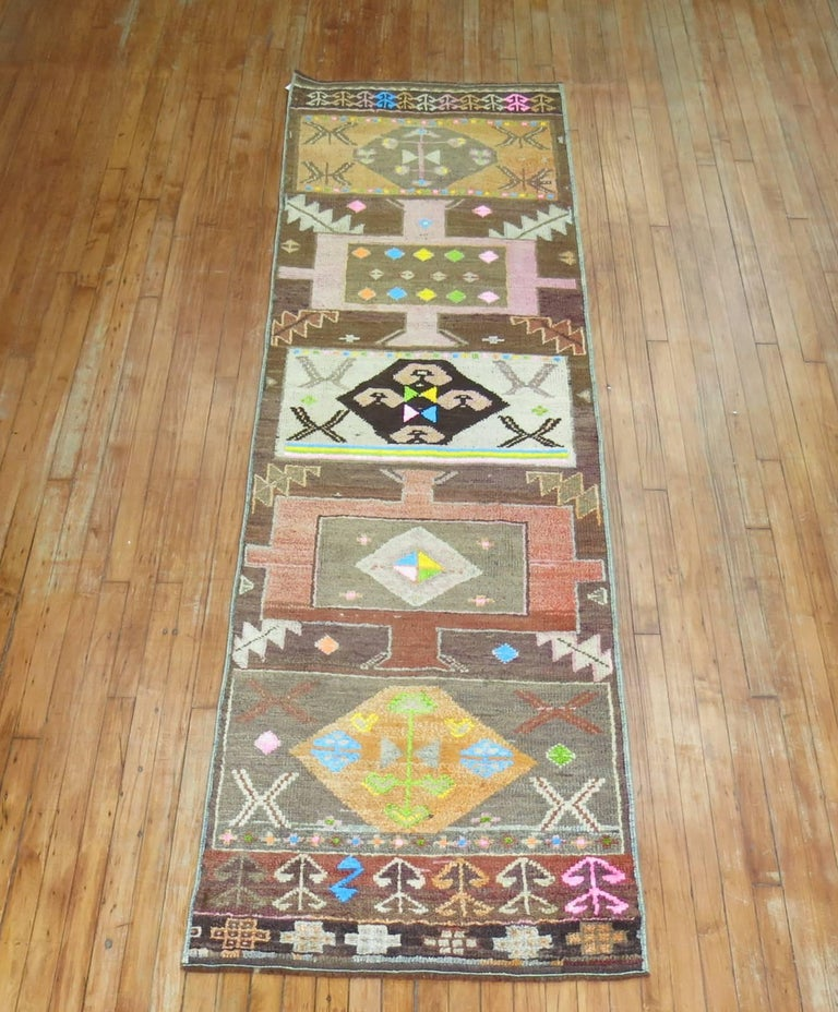 An eclectic Turkish Anatolian runner with a flashy array of electric colors and an abstract design.