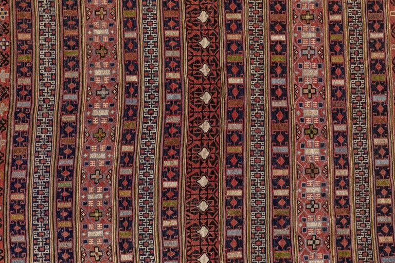 Vintage Turkish flat-weave RahRah Sumak rug, with brown and mauve accents.
