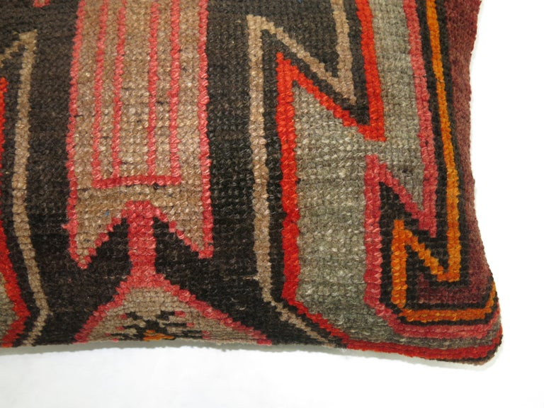 Pillow made from a vintage Turkish Kars rug.