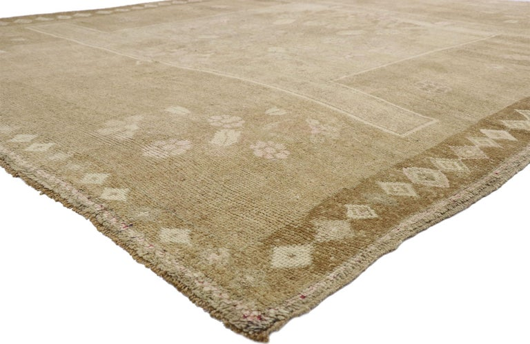 52545, vintage Turkish Kars rug with Modern Farmhouse and Romantic Prairie Style. This hand knotted wool vintage Turkish Kars rug features a large square medallion patterned with a round floral bouquet in an abrashed field. Each corner spandrel is