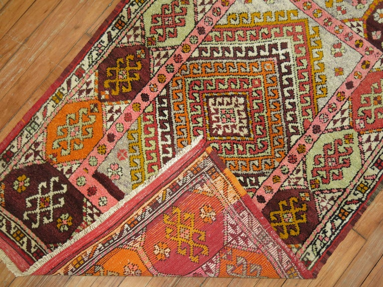 Colorful vintage Turkish Konya rug from the mid-20th century.
