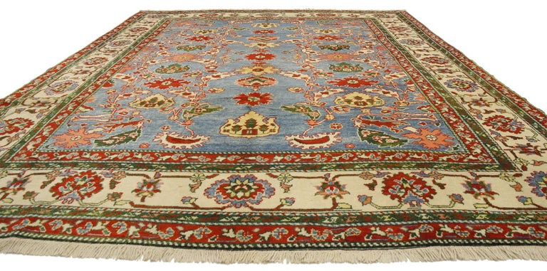77134, vintage Turkish Oushak rug. This hand-knotted wool vintage Turkish Oushak rug features an allover geometric pattern surrounded by a classic border creating a well-balanced and timeless design. This vintage Oushak rug brings a subtle elegance
