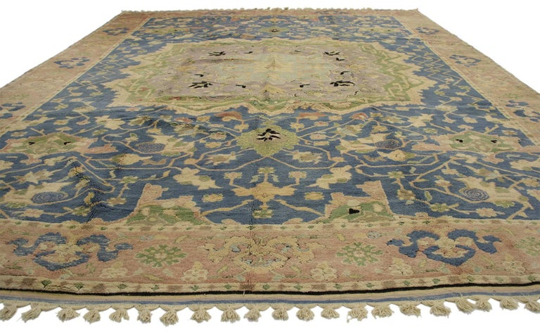 77126, vintage Turkish Oushak rug. Give your home fashion-forward style without going overboard with this vintage Turkish Oushak rug. This hand-knotted wool vintage Oushak rug features a tri-colored grand medallion rendered in light blue, lavender