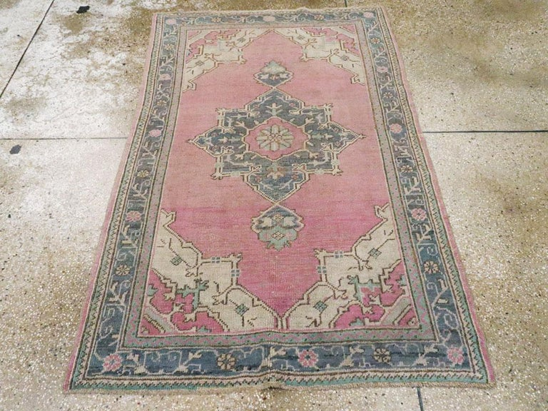 Hand-Knotted Midcentury Handmade Turkish Oushak Throw Rug In Pink and Blue-Grey For Sale