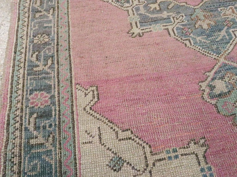 Midcentury Handmade Turkish Oushak Throw Rug In Pink and Blue-Grey In Fair Condition For Sale In New York, NY