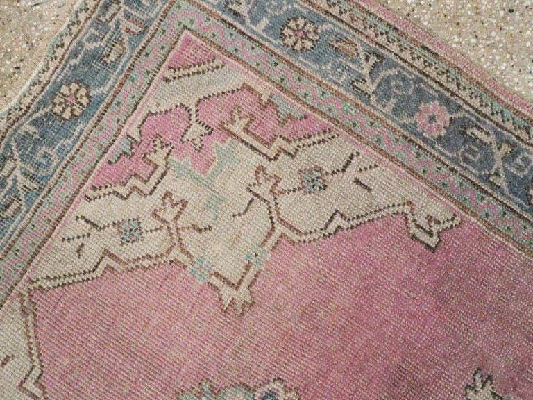 20th Century Midcentury Handmade Turkish Oushak Throw Rug In Pink and Blue-Grey For Sale