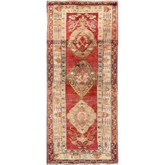 Antique Turkish Oushak Runner In Beautiful Red Background with Medallions
