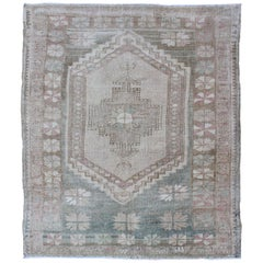 Vintage Turkish Oushak Rug with Stylized Medallion in Soft Green and Creams