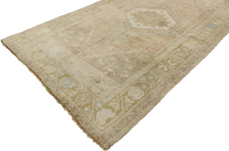 53210, vintage Turkish Oushak rug with Swedish Farmhouse style. Take a timeless, tailored design, mix in a dash of bucolic charm and antique-washed colors to get this fresh look that's as comfortable as it is chic. The abrashed field features a