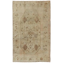 Vintage Turkish Oushak Rug with Tribal Motifs in Shades of Brown and Cream