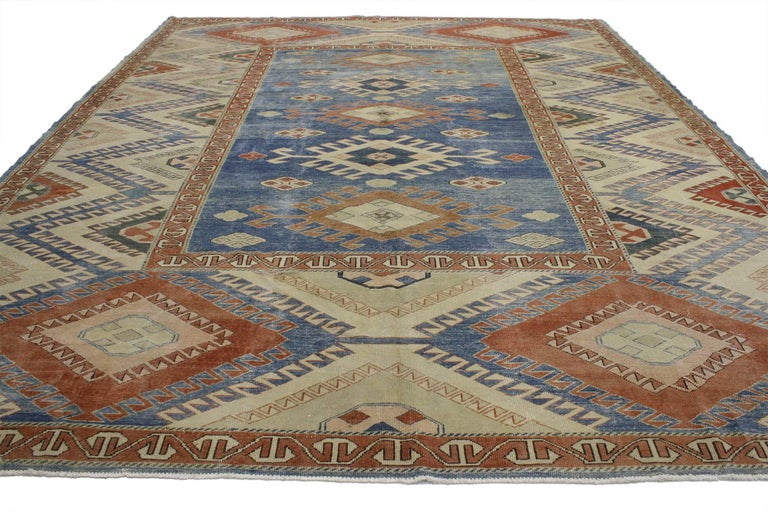 52035 Vintage Turkish Oushak Rug with Modern Nomadic Tribal Southwestern Style. Create a room that feels well-traveled and effortlessly inviting with this vintage Turkish Oushak rug. Five tarantula style amulets dotted with Turkish motifs are