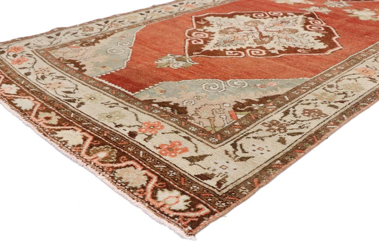 52739 vintage Turkish Oushak runner with Manor House Tudor style. With its warm, rich colors and ornate detailing, this hand knotted wool vintage Turkish Oushak runner is well-balanced and poised to impress. Three cusped lozenge medallions patterned