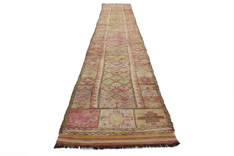 52064, vintage Turkish Oushak runner, long and narrow hallway. This hand-knotted wool vintage Turkish Oushak runner with tribal style features an allover diamond lozenge pattern in an abrashed field. A compartmental border composed of rosettes and